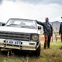 Fixers Thabo Ntlhoki (left) and Tumelo Makhetha (right), pictured with their pick up truck in Lesotho, Africa. Lesotho lacks the big 5 game animals that attract tourists to safaris in neighbouring countries. People like Thabo and Tumelo are looking towards adventure tours and races to increase Lesotho's tourism.