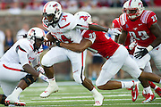 DALLAS, TX - AUGUST 30: Kenny Williams #34 of the Texas Tech Red Raiders breaks free against the SMU Mustangs on August 30, 2013 at Gerald J. Ford Stadium in Dallas, Texas.  (Photo by Cooper Neill/Getty Images) *** Local Caption *** Kenny Williams