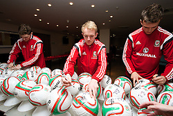 CARDIFF, WALES - Tuesday, March 4, 2014: Wales' Ben Davies, Jonathan Williams and Emyr Huws during a signing session at the St. David's Hotel ahead of the International Friendly against Iceland. (Pic by David Rawcliffe/Propaganda)  CARDIFF, WALES - Tuesday, March 4, 2014: Wales' xxxx during a training session at the Cardiff City Stadium ahead of the International Friendly against Iceland. (Pic by David Rawcliffe/Propaganda)