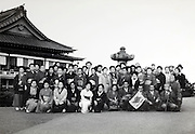 sightseeing group portrait at a temple Japan 1950s - 60s