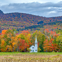 This New England fall foliage season I returned to New Hampshire to photograph the iconic Wonalancet Union Church in Tamworth, NH framed by beautiful fall foliage. <br />