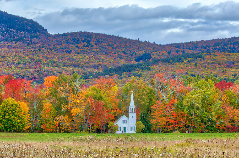 This New England fall foliage season I returned to New Hampshire to photograph the iconic Wonalancet Union Church in Tamworth, NH framed by beautiful fall foliage. <br /> <br /> New Hampshire White Mountains fall foliage photography images of the Wonalancet Union Church available as museum quality photo, canvas, acrylic, wood or metal prints. Wall art prints may be framed and matted to the individual liking and interior design decoration needs:<br /> <br /> https://juergen-roth.pixels.com/featured/new-hampshire-fall-foliage-at-the-wonalancet-union-church-juergen-roth.html<br /> <br /> Contact Juergen directly for photo wall art murals.<br /> <br /> Good light and happy photo making!<br /> <br /> My best,<br /> <br /> Juergen