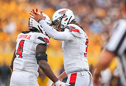 Oct 2, 2021; Morgantown, West Virginia, USA; Texas Tech Red Raiders running back SaRodorick Thompson (4) scores a touchdown and celebrates with Texas Tech Red Raiders quarterback Henry Colombi (3) during the first quarter against the West Virginia Mountaineers at Mountaineer Field at Milan Puskar Stadium. Mandatory Credit: Ben Queen-USA TODAY Sports