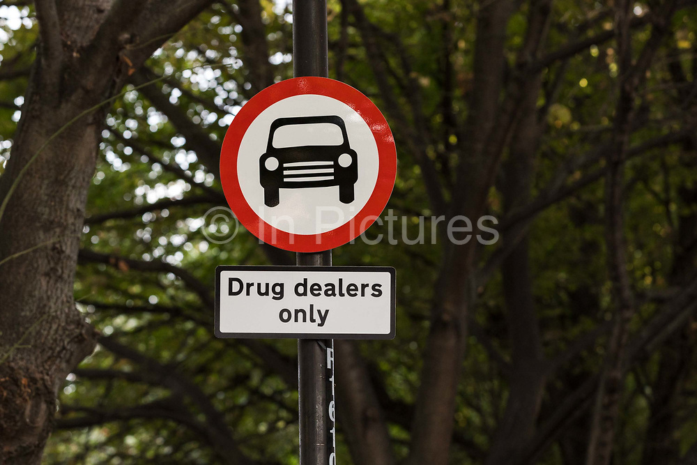 Community activists from the 'Columbia Road Cartel' erect hoax 'Drug dealers only' road signs as part of the anti drugs street art campaign in residential streets near Columbia Road in Shoreditch east London on September 16, 2018 to highlight high levels of drug dealing in this part of Tower Hamlets, where the cheapest heroin in Europe can allegedly be purchased. The road signs and markings were commissioned by residents from the Weavers Community Action Group who claim that the police and Tower Hamlets Council are failing to address the growing drugs problem in the area.  (photo by Vickie Flores / In Pictures via Getty Images)