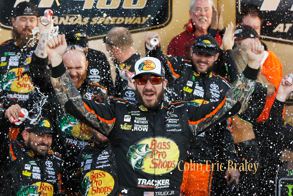 Martin Truex Jr. celebrates winning the NASCAR Cup Series auto race at Kansas Speedway in Kansas City, Kan., Sunday, Oct. 22, 2017. (AP Photo/Colin E. Braley)