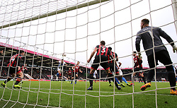 Brighton & Hove Albion's Florin Andone (second left) scores his side's third goal of the game during the Emirates FA Cup, third round match at the Vitality Stadium, Bournemouth.