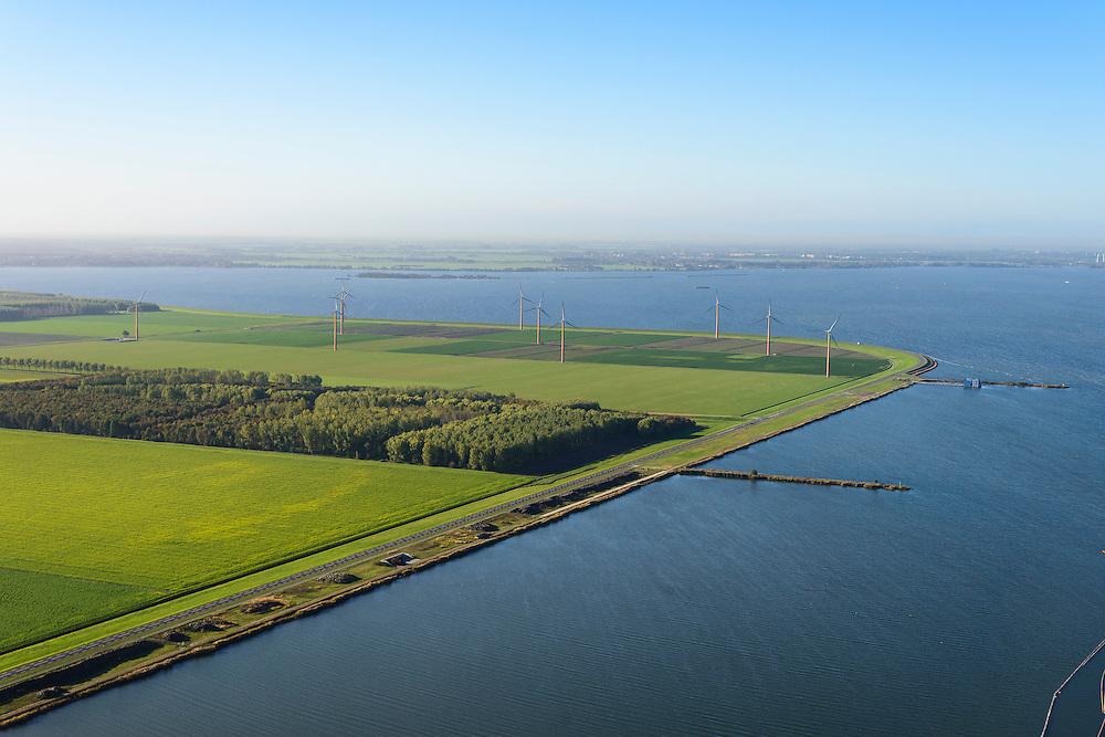Nederland, Flevoland, Gemeente Almere, 24-10-2013; Almere-Pampus, Kustzone Almere. Zicht op Muiderhoek, locatie voor een mogelijke IJmeerverbinding (IJmeerlijn). Het bos is het Land Art project Polderland Garden of Love and Fire van architect Daniel Libeskind. Foto richting Muiden.<br /> Windmills along the coast in Almere Poort, viewed in direction Muiden.<br /> luchtfoto (toeslag op standaard tarieven);<br /> aerial photo (additional fee required);<br /> copyright foto/photo Siebe Swart.