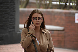 Melisa Birkinshaw, from Derby, leaves Birmingham Crown Court after pleading guilty to helping on-the-run killer Tyrone Andrew in 2017 by giving him cash and a mobile phone.