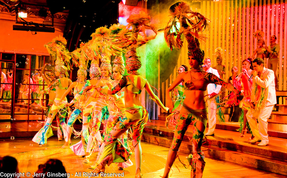 Cuban cabaret revue filled with colorful costumes, singing and dancing in Havana, Habana, Cuba.