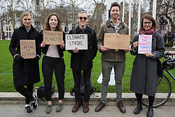 London, UK. 8th March, 2019. Campaigners for action on climate change protest opposite the Houses of Parliament in Parliament Square as part of the Fridays for Future climate strikes.