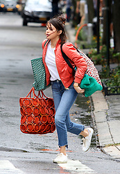 Selena Gomez gets caught in the rain carrying big bags while filming scenes for Woody Allen's latest untitled movie project in Manhattan's West Village Neighborhood. 19 Sep 2017 Pictured: Selena Gomez. Photo credit: LRNYC / MEGA TheMegaAgency.com +1 888 505 6342