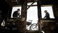 Rene Wildhaber and Ross Schnell stand up next to their old Swiss army bike during the Red Bull Buffalo Soldier Mountain Bike Trip in USA in Animas Forks (Colorado), on October 09th 2012.