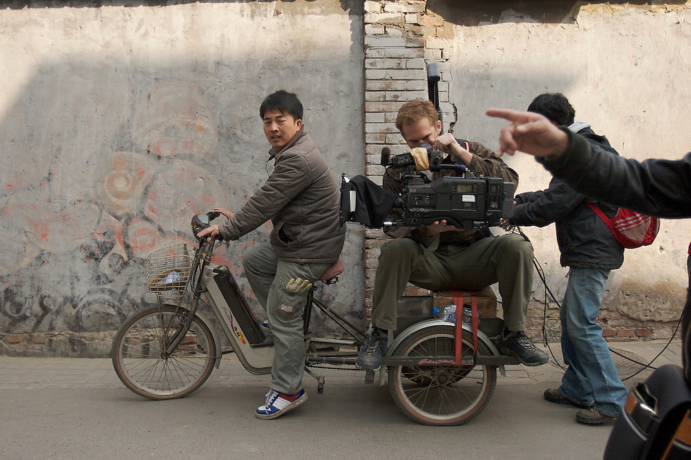 A film shoot uses more creative methods in lue of a dolly in the Xinjiekou area of Beijing, China.