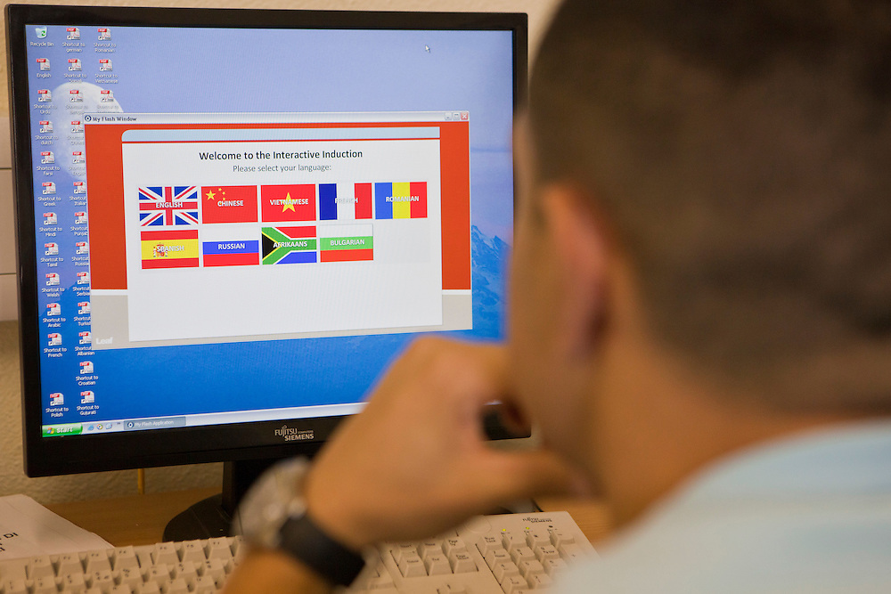 Prisoners watch the induction program  for new inmates on E wing. The can select a variety of languages. HMP Wandsworth, London, United Kingdom