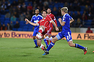 Peter Whittingham of Cardiff city © challenges Jonathan Parr of Ipswich (r).Skybet football league championship match, Cardiff city v Ipswich Town at the Cardiff city stadium in Cardiff, South Wales on Tuesday 21st October 2014<br /> pic by Andrew Orchard, Andrew Orchard sports photography.