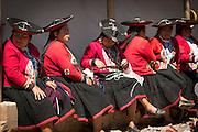 Local Quechua women in traditional dress at Chinchero Town Sunday Market, Peru, South America
