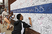 Fans paid their respects to B.B. King outside of his Memphis Blues Club by laying flowers on the musical note dedicated to him on Beale Street in Memphis, Tennessee on Saturday. They are also signing a giant banner nearby. B.B. was a nick name given to him on Beale Street.  His nick name was Beale Street Blues Boy. The Mississippi-born legend died in his sleep at 11:40 p.m on Thursday night. King made a name for himself as a young man, as a blues artist on Beale Street in Memphis, where he later opened a namesake club. (Photo by Karen Pulfer Focht)