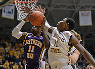 WICHITA, KS - JANUARY 05:  Forward Cleanthony Early #11 of the Wichita State Shockers blocks the shot of guard Wes Washpun #11 of the Northern Iowa Panthers during the second half on January 5, 2014 at Charles Koch Arena in Wichita, Kansas.  Wichita State defeated Northern Iowa 67-53. (Photo by Peter Aiken/Getty Images) *** Local Caption *** Cleanthony Early;Wes Washpun