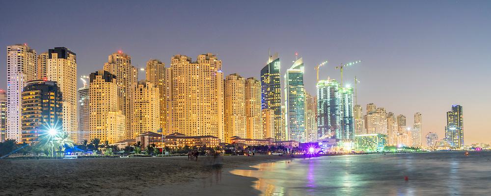 Night view of beach and skyline of high-rise apartment blocks at JBR Jumeirah Beach Residences in Dubai UAE