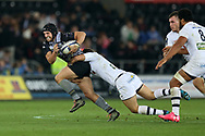Dan Evans of the Ospreys (l) tries to make a break. European Rugby Champions Cup, pool 2 match, Ospreys v ASM Clermont Auvergne at the Liberty Stadium in Swansea, South Wales on Sunday 15th October 2017.<br /> pic by  Andrew Orchard, Andrew Orchard sports photography.
