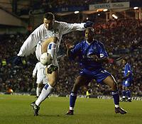 Photo. Jed Wee<br />Leeds United v Gillingham, AXA FA Cup Replay, Elland Road, Leeds. 04/02/2003.<br />Leeds' Mark Viduka (L) shows close control despite the close attentions of Gillingham's Leon Johnson.