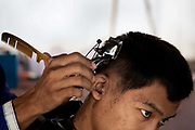 A young boy, age 15,  is having his hair cut. The boy was arrested with his friend in April 2010 for rape, reported by a local girl, also 14. The girl was not able to identify any of the boys but witnesses saw them in the fields near by. Sok, 15. ( not real name) Children are according to the law supposed to go to trial within 6 months of arrest but many wait up to a year before a sentencing regardless of the severity of the offence. Battambang provincial prison has 1170 inmates ( capacity 700) including 37 children and youths under 18. Most cases amongst the boys are rape, a few murders and robbery. Stealing food & drink to eat is considered a robbery if offence is commited by two or more individuals and comes with severe punishment. Most of cases amongst girls are robbery. Without LAC none of these children would have any legal representaion. Being arrested by police on suspicion of commiting a crime they can spend up to a year awaiting trial, if convicted ( rape is 1-4 years) they can expect to wait up to several years for an appeal hearing.