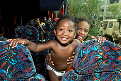 01 Sept, 2005. New Orleans, Louisiana.<br /> Louisiana. Mass evacuation begins. The smile says it all. A delighted mother and child board the first bus out of New Orleans.<br /> Photo©; Charlie Varley/varleypix.com