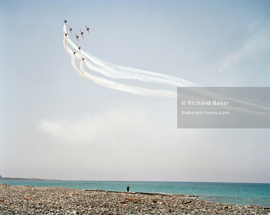 Haw jets of the Red Arrows, Britain's RAF aerobatic team practice display using Cyprus coast as display datum (centre).