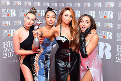 Little Mix's Perrie Edwards (L - R), Leigh-Anne Pinnock, Jesy Nelson and Jade Thirlwall with the award for Best Single in the press room during the Brit Awards at the O2 Arena, London.