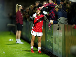 Arsenal's Mana Iwabuchi celebrates with fans after the final whistle during the Vitality Women's FA Cup quarter final match at Borehamwood, London. Picture date: Wednesday September 29, 2021.