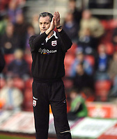 Photo: Jonathan Butler.<br />Southampton v Ipswich Town. Coca Cola Championship. 24/02/2007.<br />George Burley Southampton manager congratulates his players.