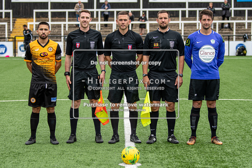 BROMLEY, UK - SEPTEMBER 22: Captains & match officials before the Emirates FA Cup Second Round Qualifier match between Cray Wanderers and Soham Town Rangers at Hayes Lane on September 22, 2019 in Bromley, UK. <br /> (Photo: Jon Hilliger)
