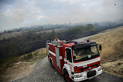 August 16, 2017 - Sakartsi, Sofia, Bulgaria - Fire truck is moving some 100 metres from the Bulgarian-Turkish border fence, trying to stop the fire go in Turkey. Fire destroyed near 2000 acres between the villages of Sakartsi and Matochina, which are located along the Bulgarian-Turkish border fence and 270 kilometres East the Bulgarian capital of Sofia. More than 50 people, firefighters, volunteers and the people from the villages are working on place, Matochina, Bulgaria on August 16, 2017  (Credit Image: © Hristo Rusev/NurPhoto via ZUMA Press)