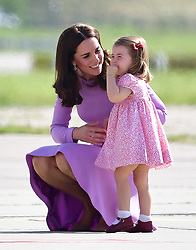 Princess Charlotte with her mother the Duchess of Cambridge as they visit Airbus in Hamburg, Germany with the Duke of Cambridge and Prince Geaorge.