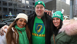 Irish rugby fans celebrate their team's Grand Slam victory outside the Pig and Whistle Irish pub in New York City.