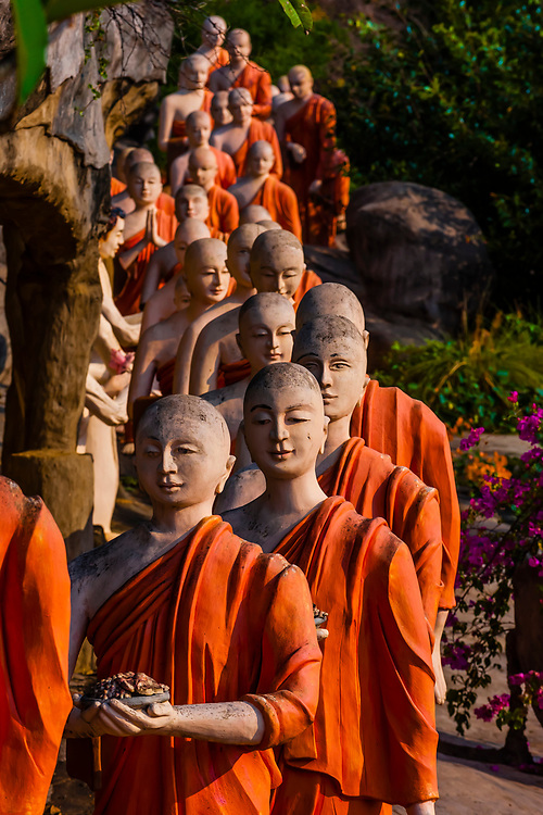 Statues of a line of Buddhist monks, Golden Temple, Dambulla