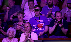 Spectator wearing binoculars during day seventeen of the 2018 Betfred World Championship at The Crucible, Sheffield.