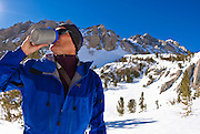 Backcountry skier enjoying a hot drink, Inyo National Forest, Sierra Nevada Mountains, California