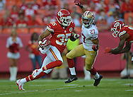 KANSAS CITY, MO - AUGUST 16:  Safety Quintin Demps #35 of the Kansas City Chiefs returns a kick-off 104-yards for a touchdown against the San Francisco 49ers during the first half on August 16, 2013 at Arrowhead Stadium in Kansas City, Missouri.  (Photo by Peter Aiken/Getty Images) *** Local Caption *** Quintin Demps