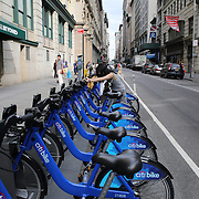 A Citi Bike docking station, Manhattan, New York. Citi Bike the NYC Bicycle Share Program sponsored by Citi Bank, launched in late May 2013 giving access to thousands of bikes at docking stations throughout  Manhattan and parts of Brooklyn. Manhattan, New York, USA. 24th July 2013. Photo Tim Clayton