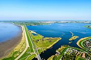 Nederland, Noord-Holland, Gemeente Hollands Kroon, 07-05-2018; Van Ewijcksluis met Balgzandkanaal wat uitmondt in het Amstelmeer. Links de Amsteldiepdijk, ook wel Kleine of Korte Afsluitdijk, richting Wieringen.<br /> Dike connecting former island Wieringen with mainland.<br /> <br /> luchtfoto (toeslag op standaard tarieven);<br /> aerial photo (additional fee required);<br /> copyright foto/photo Siebe Swart