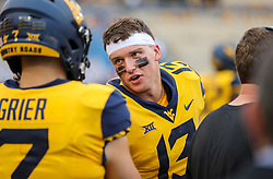 Sep 22, 2018; Morgantown, WV, USA; West Virginia Mountaineers wide receiver David Sills V (13) talks with West Virginia Mountaineers quarterback Will Grier (7) along the sidelines during the fourth quarter against the Kansas State Wildcats at Mountaineer Field at Milan Puskar Stadium. Mandatory Credit: Ben Queen-USA TODAY Sports