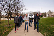 """21 NOVEMBER 2020 - DES MOINES, IOWA: People walk around the Iowa State Capitol and pray for Donald Trump before a """"Stop the Steal"""" rally. About 100 supporters of US President Donald Trump gathered at the Iowa State Capitol to rally in support of the President and in opposition to the outcome of the US election. They are a part of the """"Stop the Steal"""" movement which has spread across the US. This is the third week that there have been """"Stop the Steal"""" rallies across the US. Most independent observers and election officials, both Republican and Democratic, have said the election was free and fair and that there was no election fraud.     PHOTO BY JACK KURTZ"""