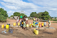 Collecting water with a large hand pump from a water well , Caia, Zambezi River Floodplain, Sofala Province, Mozambique