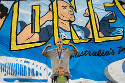 April 13, 2018 - Sydney, NSW, U.S. - SYDNEY, NSW - APRIL 13: Sydney FC midfielder Adrian Mierzejewski (11) and his son flex in front of a banner with his image on it at the A-League Soccer Match between Sydney FC and Melbourne Victory on April 13, 2018 at Allianz Stadium in Sydney, Australia. (Photo by Speed Media/Icon Sportswire) (Credit Image: © Speed Media/Icon SMI via ZUMA Press)