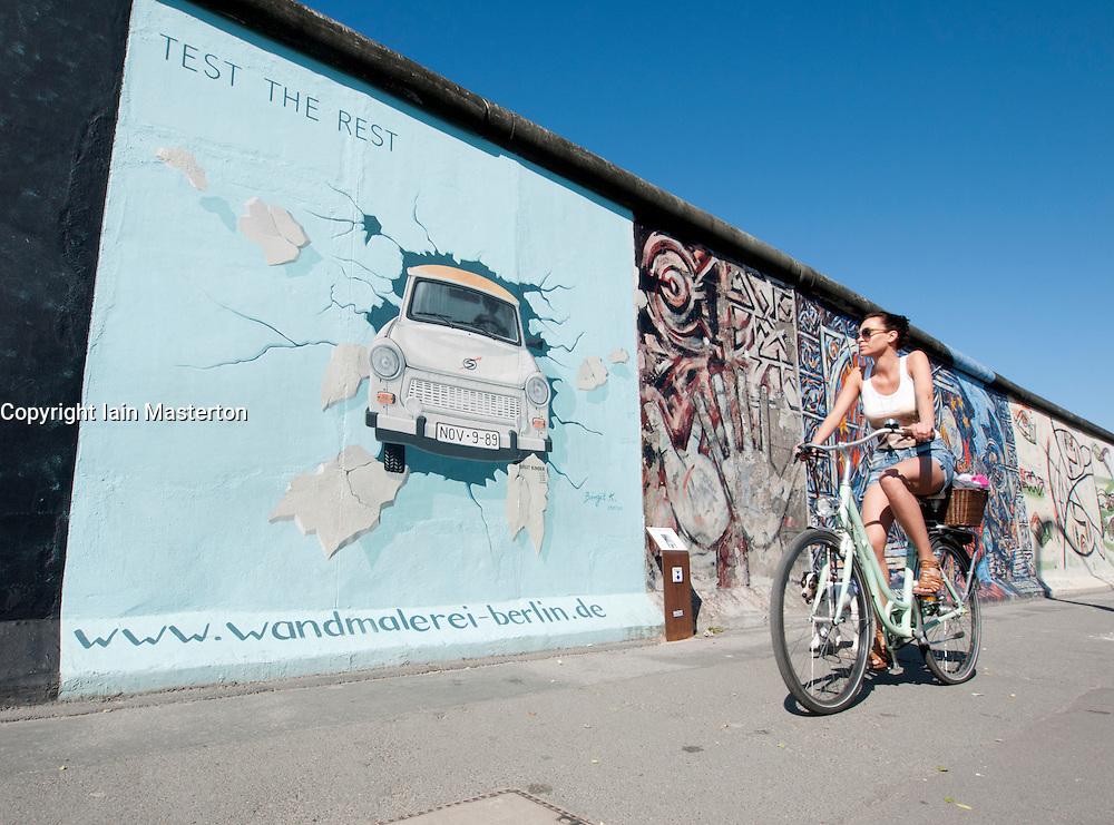 Paintings on original Berlin Wall at East Side Gallery in Berlin Germany
