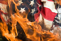 American Legion Post 43 burns several dozen American flags commemorating Flag Day, a traditional day for properly disposing of old and tattered American flags by burning them. June 14 is also the date the U.S. Army was founded in 1775, and the date Congress adopted the American flag in 1777.