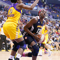 03 August 2014: Connecticut Sun forward Chiney Ogwumike (13) drives past Los Angeles Sparks forward Nneka Ogwumike (30) during the Los Angeles Sparks 70-69 victory over the Connecticut Sun, at the Staples Center, Los Angeles, California, USA.