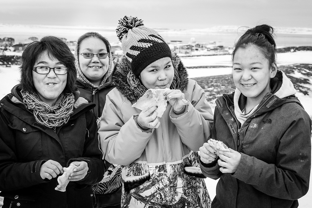 Part of the inuit culture, some piece of the caribou are eaten raw. These inuit girls love that, as you can see with their smiles.