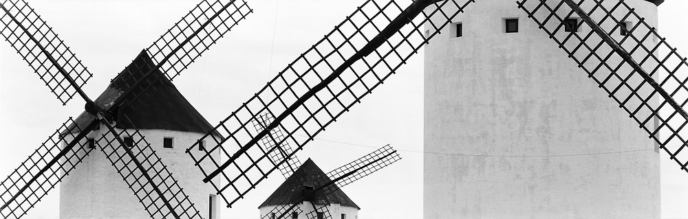 Rows of windmills in La Mancha, black and white
